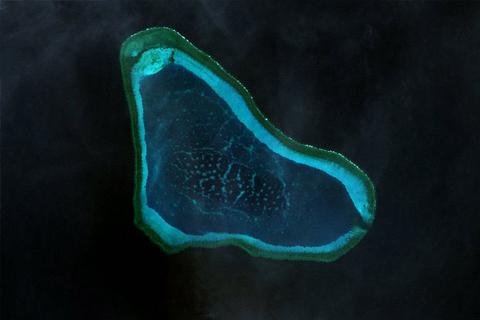 Landsat 7 image of Scarborough Shoal or Bajo de Masinloc in the South China Sea or West Philippine Sea (NASA via Wikipedia)
