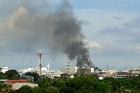 A handout photo dated and released by Philippine Information Agency-Western Mindanao on 10 September 2013 shows a fire at Sta.  Barbara township,  Zamboanga City.