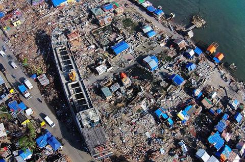 FILE PHOTO: Sa larawang ito na kuha noong December 10, 2013 mula sa UNTV drone, makikita ang isang barkong komersyo na napadpad sa isang pamayanang malapit sa pampang ng Anibong, Tacloban na matapos ang pananalasa ni supertyphoon Yolanda.  Ayon sa pagtatala ng NEDA, umabot sa P571 billion ang kabuoang halaga ng naging pinsala sa bansa. (ARGIE PURISIMA / Photoville International)