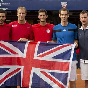 Feb 2, 2014; San Diego, CA, USA; Colin Fleming, Dominic Inglot, James Ward, Andy Murray and Captain Leon Smith (GBR) pose with the British flag after defeating the USA in their Davis Cup tie at Petco Park. Mandatory Credit: Susan Mullane-USA TODAY Sports via REUTERS