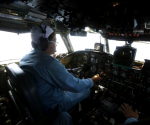 Caption Dinh Van Qua operates on the cockpit of an aircraft AN-26 belonging to the Vietnam Air Force during a search and rescue mission off Vietnam's Tho Chu island March 10, 2014.  CREDIT: REUTERS/KHAM