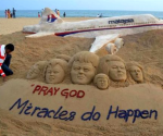 Indian sand artist Sudarshan Patnaik applies the final touches to a sand art sculpture he created wishing for the well being of the passengers of Malaysian Airlines flight MH370, on a beach in Puri, in Odisha, March 9, 2014. CREDIT: REUTERS/STRINGER
