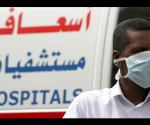 A man, wearing a surgical mask as a precautionary measure against the novel coronavirus, walks near a hospital in Khobar city in Dammam. REUTERS/Stringer