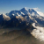 Mount Everest (C), the world's highest peak, and other peaks of the Himalayan range are seen from air during a mountain flight from Kathmandu, in this file picture taken April 24, 2010.  CREDIT: REUTERS/TIM CHONG/FILES