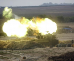 An Israeli mobile artillery unit fires towards the Gaza Strip July 28, 2014. CREDIT: REUTERS/BAZ RATNER
