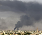 Black plumes of smoke is seen in the vicinity of Camp Thunderbolt, after clashes between militants, former rebel fighters and government forces in Benghazi July 27, 2014.  CREDIT: REUTERS/ESAM OMRAN AL-FETORI