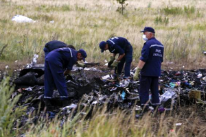 Members of the Ukrainian Emergencies Ministry work at a crash site of Malaysia Airlines Flight MH17, near the village of Hrabove, Donetsk region July 20, 2014.  CREDIT: REUTERS/MAXIM ZMEYEV