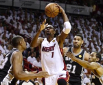 Jun 12, 2014; Miami, FL, USA; Miami Heat center Chris Bosh (1) shoots against San Antonio Spurs forward Boris Diaw (left) during the first quarter of game four of the 2014 NBA Finals at American Airlines Arena. Bob Donnan-USA TODAY Sports