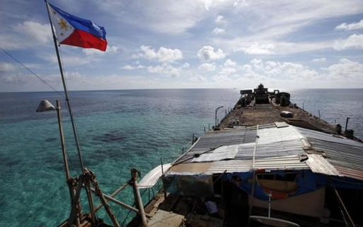 A Philippine national flag flutters in the wind aboard the BRP Sierra Madre, run aground on the disputed Second Thomas Shoal, part of the Spratly Islands, in the South China Sea March 29, 2014. CREDIT: REUTERS/ERIK DE CASTRO