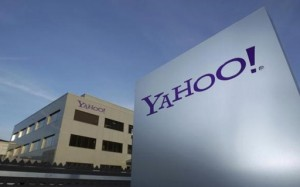 A Yahoo logo is pictured in front of a building in Rolle, 30 km (19 miles) east of Geneva, in this file picture taken December 12, 2012. CREDIT: REUTERS/DENIS BALIBOUSE/FILES