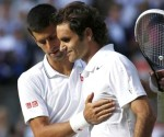 Novak Djokovic of Serbia speaks with Roger Federer of Switzerland after defeating him in their men's singles finals tennis match on Centre Court at the Wimbledon Tennis Championships in London July 6, 2014. CREDIT: REUTERS/POOL