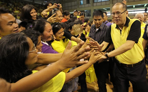 FILE PHOTO: President Benigno S. Aquino III shakes hands with the residents of Dipolog City during his visit at the Andres Bonifacio College (ABC) Gymnasium in Barangay Miputak, Dipolog City, Zamboanga del Norte on Tuesday (February 05). ( Jay Morales / Malacañang Photo Bureau)
