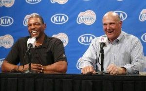 Los Angeles Clippers' new owner Steve Ballmer (R) speaks at a news conference with coach Doc Rivers after being introduced at a fan event at the Staples Center in Los Angeles, California August 18, 2014. CREDIT: REUTERS/LUCY NICHOLSON