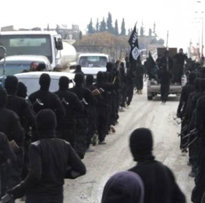Fighters of al-Qaeda linked Islamic State of Iraq and the Levant parade at the Syrian town of Tel Abyad, near the border with Turkey January 2, 2014.  CREDIT: REUTERS/YASER AL-KHODOR