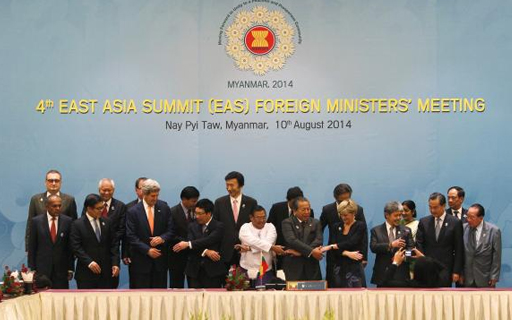 Dignitaries hold hands as they pose for a photo before the 4th East Asia Summit (EAS) Foreign Ministers Meeting at the Myanmar International Convention Centre (MICC) in Naypyitaw, August 10, 2014. CREDIT: REUTERS/ SOE ZEYA TUN