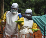Medical staff working with Medecins sans Frontieres (MSF) prepare to bring food to patients kept in an isolation area at the MSF Ebola treatment centre in Kailahun July 20, 2014. CREDIT: REUTERS/TOMMY TRENCHARD