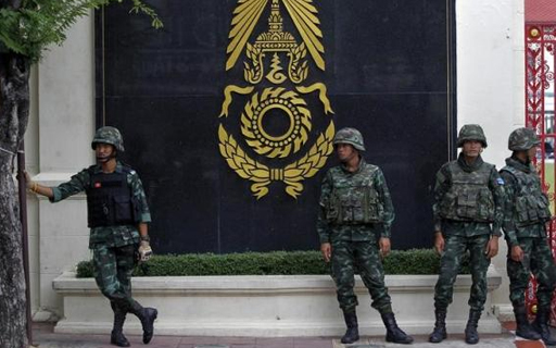 Thai soldiers stand guard outside the Royal Thai Army Headquarters as members of the Radio and Satellite Broadcasters gather in Bangkok June 18, 2014. CREDIT: REUTERS/CHAIWAT SUBPRASOM
