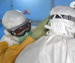 Dr. Joel Montgomery, team leader for the U.S. Centers for Disease Control and Prevention Ebola Response Team in Liberia, is dressed in his personal protective equipment while adjusting a colleague's PPE before entering the Ebola treatment unit in Monrovia, Liberia's capital city in this recent photo released on September 16, 2014. CREDIT: REUTERS/ATHALIA CHRISTIE/CDC/HANDOUT