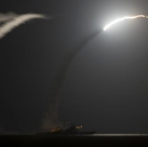 The guided-missile cruiser USS Philippine Sea (CG 58) launches a Tomahawk cruise missile, as seen from the aircraft carrier USS George H.W. Bush (CVN 77), in the Arabian Gulf in this handout photograph taken and provided on September 23, 2014.  REUTERS/Mass Communication Specialist 1st Class Eric Garst/U.S. Navy/Handout