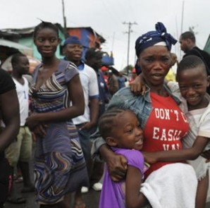 Residents of West Point celebrate the lifting of a quarantine by the Liberian government, in Monrovia August 30, 2014.  CREDIT: REUTERS/2TANGO