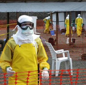 Medicins Sans Frontieres (MSF) health workers prepare at ELWA's isolation camp during the visit of Senior United Nations (U.N.) System Coordinator for Ebola David Nabarro, at the camp in Monrovia August 23, 2014. CREDIT: REUTERS/2TANGO