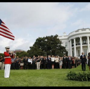 (L to R) U.S. President Barack Obama, U.S. first lady Michelle Obama and Vice President Joe Biden observe a moment of silence on the 13th anniversary of the 9/11 attacks at the White House in Washington September 11, 2014. CREDIT: REUTERS/KEVIN LAMARQUE