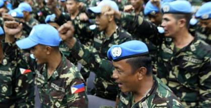 Ang pagdating ng mga Filipino UN Peacekeeping Forces nitong Linggo, September 21, 2014 sa Manila International Airport. (Photoville International)
