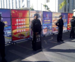 Policemen in riot gear guard a checkpoint on a road near a courthouse where ethnic Uighur academic Ilham Tohti's trial is taking place in Urumqi, Xinjiang Uighur Autonomous Region September 17, 2014. CREDIT: REUTERS/STRINGER