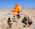 Shi'ite fighters, who have joined the Iraqi army to fight against militants of the Islamic State, formerly known as the Islamic State of Iraq and the Levant, take part in field training in the desert in the province of Najaf, September 16, 2014. CREDIT: REUTERS/ALAA AL-MARJANI