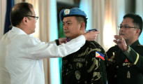 President Benigno S. Aquino III—assisted by Armed Forces of the Philippines Chief of Staff General Gregorio Pio Catapang Jr.—honors members of the 7th Philippine Contingent to the Golan Heights, during the heroes' welcome held at Malacañan Palace. The President delivered this speech during the ceremonies: http://www.gov.ph/2014/10/01/speech-president-aquino-heroes-welcome-ceremony-for-the-7th-philippine-contingent-to-the-golan-heights/ — October 01, 2014.  Photo by the Malacañang Photo Bureau.