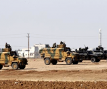 Turkish armoured army vehicles take position on the Turkish-Syrian border near the southeastern town of Suruc in Sanliurfa province October 7, 2014. CREDIT: REUTERS/UMIT BEKTAS