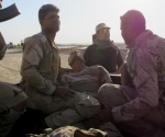 Iraqi Army personnel transport a wounded soldier after a mortar attack in Jurf al-Sakhar, south of Baghdad October 26, 2014.  CREDIT: REUTERS/STRINGER