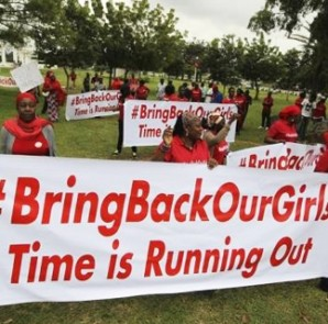 Demonstrators hold up banners during a rally that was held to mark the 120th day since the abduction of two hundred school girls by the Boko Haram, in Abuja August 12, 2014.  CREDIT: REUTERS/AFOLABI SOTUNDE