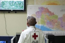 A member of El Salvador's Red Cross observes a screen after a magnitude 7.3 earthquake struck late on Monday, at a Red Cross office in San Salvador October 13, 2014. CREDIT: REUTERS/JOSE CABEZAS