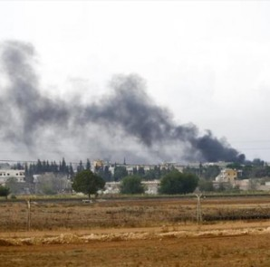 Smoke rises from the Syrian town of Kobani, seen from the Mursitpinar border crossing on the Turkish-Syrian border in the southeastern town of Suruc in Sanliurfa province, October 16, 2014.  CREDIT: REUTERS/KAI PFAFFENBACH
