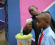 A school official takes a pupil's temperature using an infrared digital laser thermometer in front of the school premises, at the resumption of private schools, in Lagos in this September 22, 2014 file photo. CREDIT: REUTERS/AKINTUNDE AKINLEYE/FILES