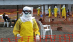 FILE PHOTO: Medicins Sans Frontieres (MSF) health workers prepare at ELWA's isolation camp during the visit of Senior United Nations (U.N.) System Coordinator for Ebola David Nabarro, at the camp in Monrovia August 23, 2014. CREDIT: REUTERS/2TANGO