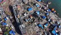 FILE PHOTO: Sa larawang ito na kuha noong December 10, 2013 mula sa UNTV drone technology, makikita ang isang barkong  pangkomersyo na napadpad sa isang pamayanang malapit sa pampang ng Anibong, Tacloban matapos ang pananalasa ni supertyphoon Yolanda. Ayon sa pagtatala ng NEDA, umabot sa P571 billion ang kabuoang halaga ng naging pinsala ni Yolanda sa bansa. (ARGIE PURISIMA / Photoville International)