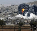 An explosion following an air strike is seen in central Kobani in Syria, November 17, 2014.  CREDIT: REUTERS/OSMAN ORSAL