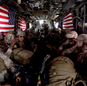 U.S. Marines are seen on board a helicopter at Kandahar air base upon the end of operations for the Marines and British combat troops in Helmand October 27, 2014. CREDIT: REUTERS/OMAR SOBHANI