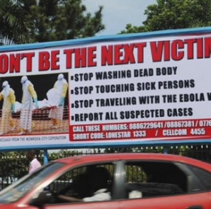 A car drives past a public health advertisement against the Ebola virus in Monrovia October 8, 2014. CREDIT: REUTERS/JAMES GIAHYUE