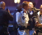 Police rescue personnel carry an injured woman from the Lindt cafe, where hostages are being held, at Martin Place in central Sydney December 16, 2014. REUTERS/Jason Reed