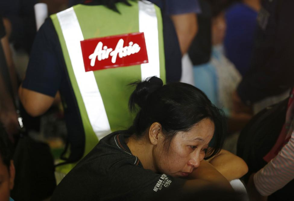 A family member of a passenger onboard the missing AirAsia flight QZ8501 react as waiting news at a waiting area in Juanda International Airport, Surabaya December 29, 2014. REUTERS/Beawiharta