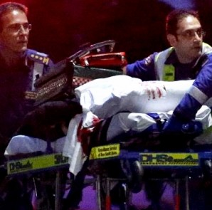 Paramedics remove a person, with bloodstains on the blankets covering the person, on a stretcher from the Lindt cafe, where hostages were being held, at Martin Place in central Sydney December 16, 2014. REUTERS/David Gray