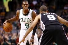 Boston Celtics guard Rajon Rondo (9) dribbles the ball against San Antonio Spurs guard Tony Parker (right) during the first half at TD Garden. Mandatory Credit: Mark L. Baer-USA TODAY Sports