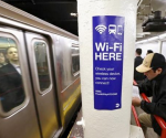 A sign advertises Wi-Fi service in the Times Square Subway station in New York, April 25, 2013. CREDIT: REUTERS/BRENDAN MCDERMID