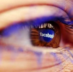 A Facebook logo reflected in the eye of a woman is seen in this picture illustration taken in Skopje November 6, 2014. Picture take November6. CREDIT: REUTERS/OGNEN TEOFILOVSKI