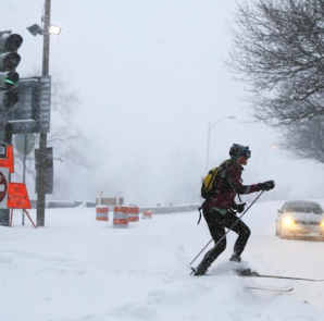 A woman cross country skis on snow covered roads during a winter blizzard in Boston, Massachusetts January 27, 2015. REUTERS/Brian Snyder