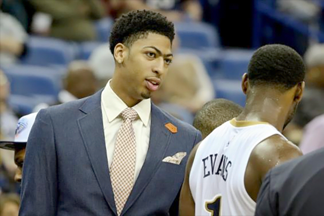 Feb 9, 2015; New Orleans, LA, USA; New Orleans Pelicans forward Anthony Davis out with a sprained shoulder talks with guard Tyreke Evans (1) during the third quarter of a game against the Utah Jazz at the Smoothie King Center. The Jazz defeated the Pelicans 100-96. Mandatory Credit: Derick E. Hingle-USA TODAY Sports