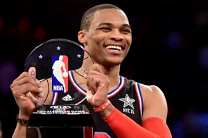 February 15, 2015; New York, NY, USA; Western Conference guard Russell Westbrook of the Oklahoma City Thunder (0) wins the MVP trophy after the 2015 NBA All-Star Game at Madison Square Garden. The West defeated the East 163-158. Mandatory  Credit: Bob Donnan-USA TODAY Sports